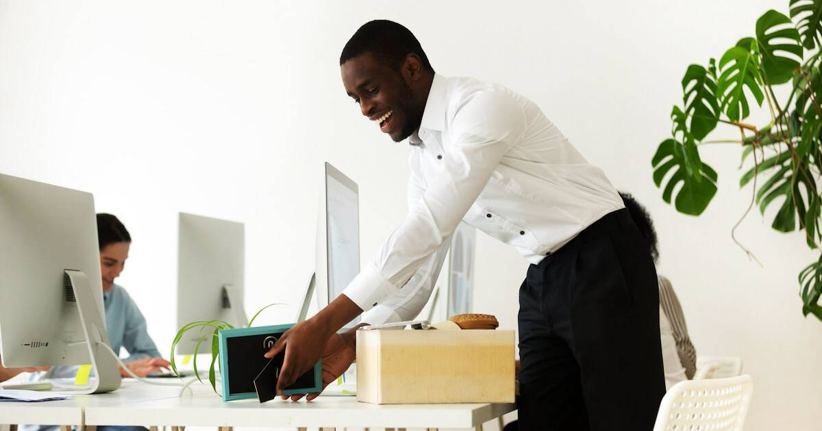 Photo of African-American man unpacking his desk first day at new job. Pick Your Job Title pbs rewire