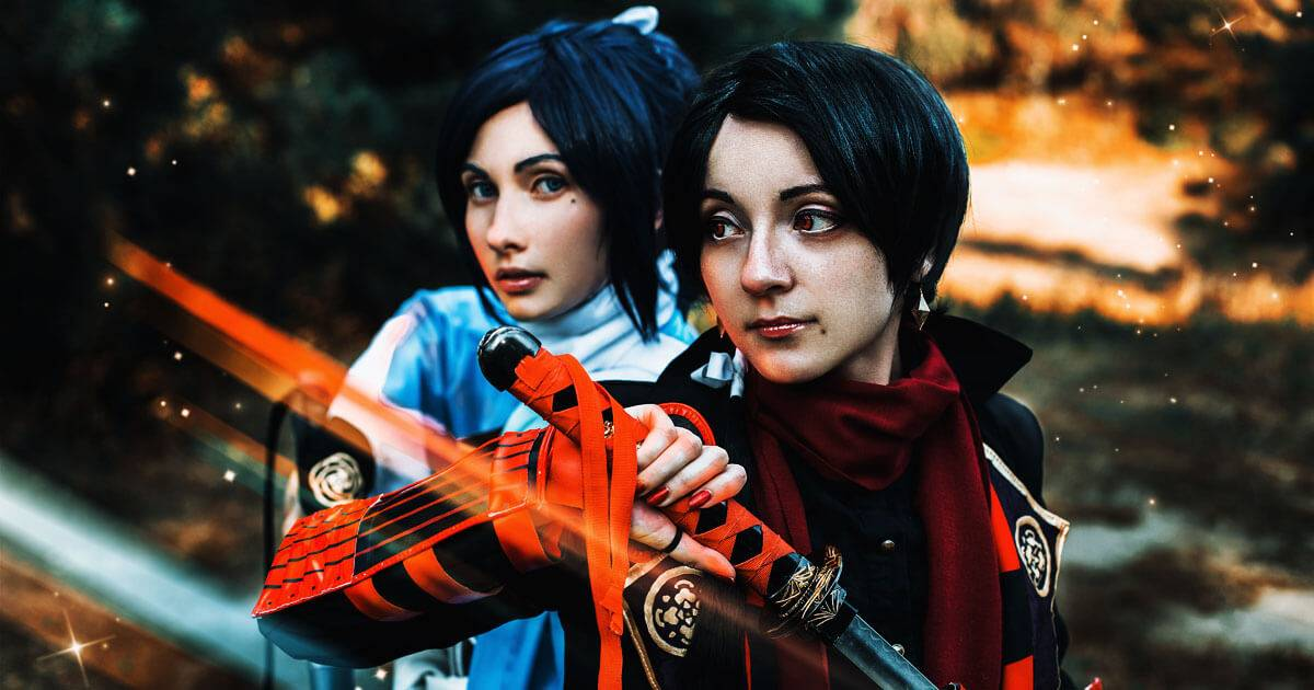 Two women dressed in cosplay holding swords. geek culture.