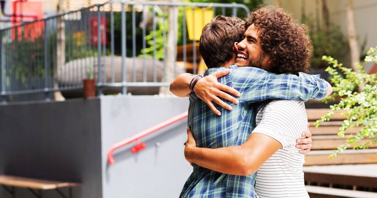 Photo of two men hugging each other. Masculinity pbs rewire