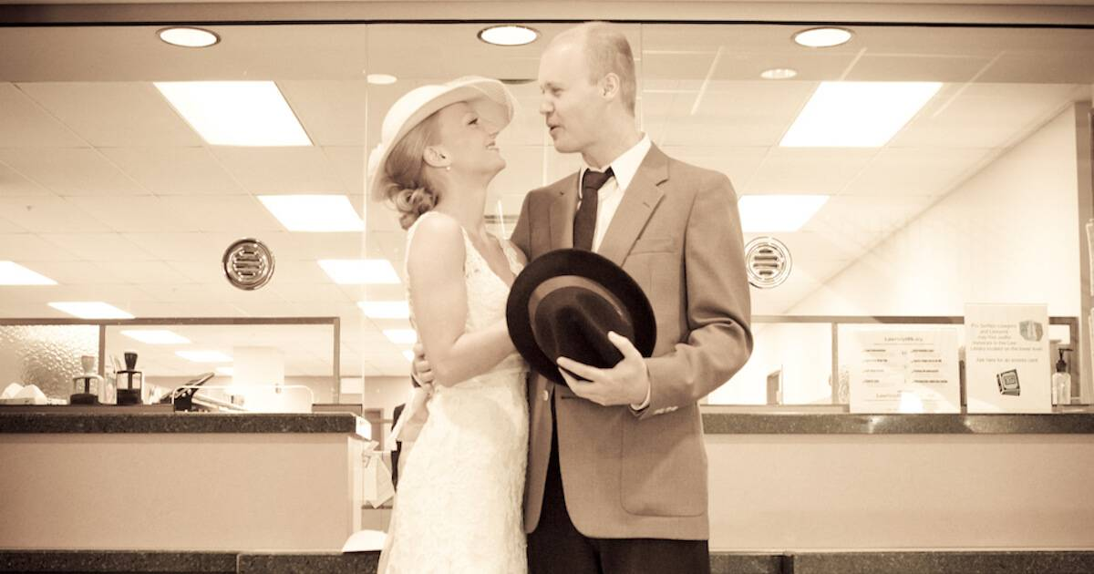 Photo of couple getting married in a courthouse. Eloped pbs rewire