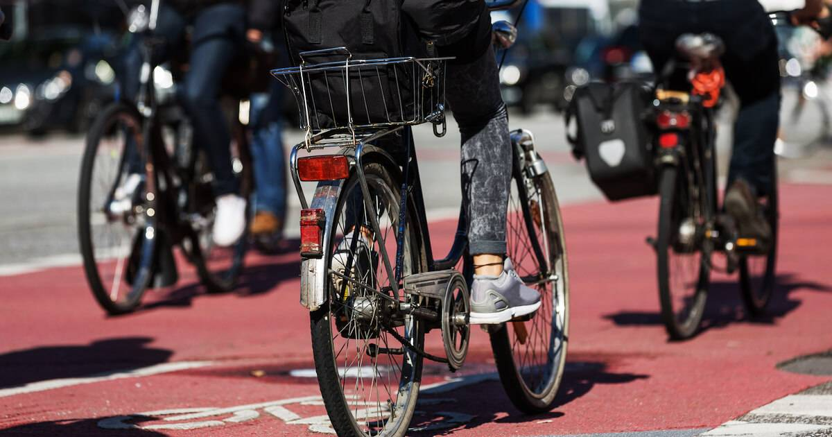 Photo of bicycle commuters riding next to car traffic. Mobility Justice pbs rewire