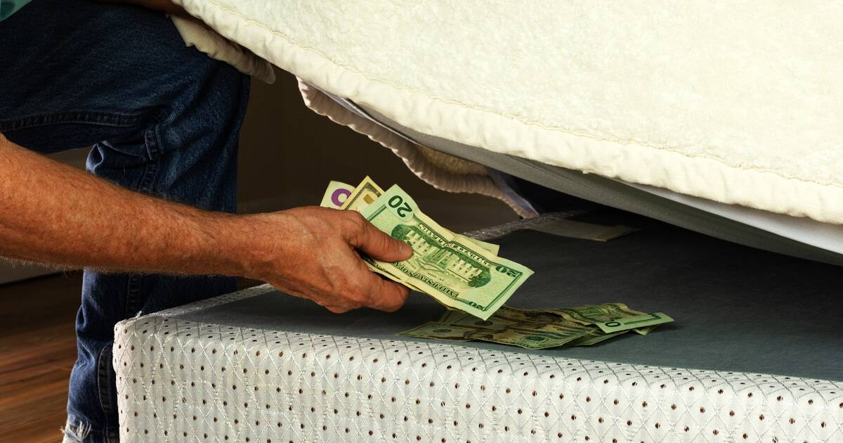 Photo of man stashing cash under his mattress. Enough Money pbs rewire