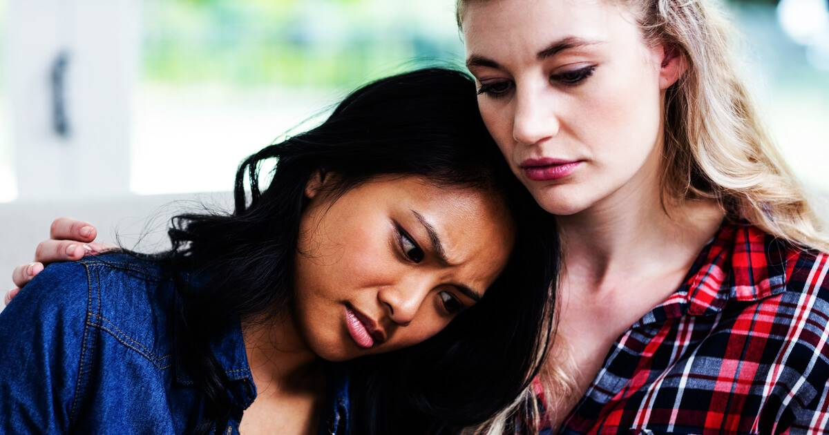 Photo of woman consoling her female friend. PTSD After Shootings pbs rewire