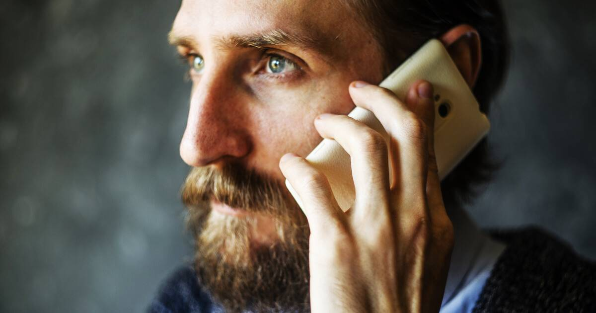 Photo of serious man with a beard listening to his smartphone. Say 'No' to a Friend pbs rewire