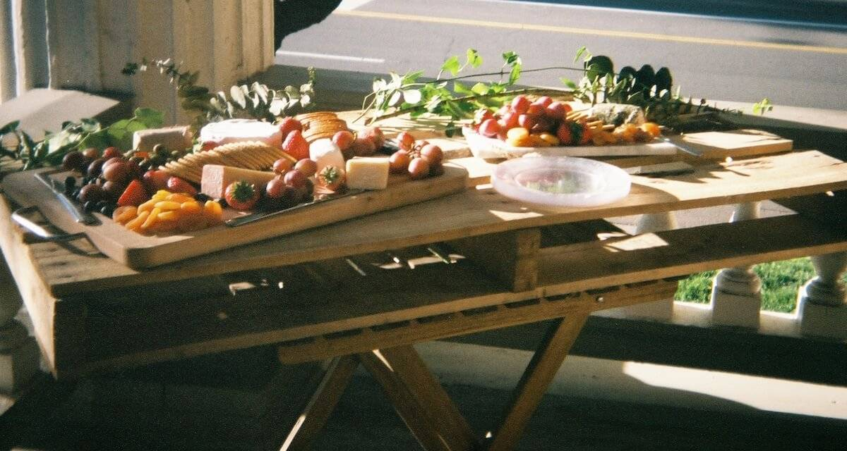 Photo of small table with spread of cheese and vegetables. Phone-Free Dinner Party pbs rewire