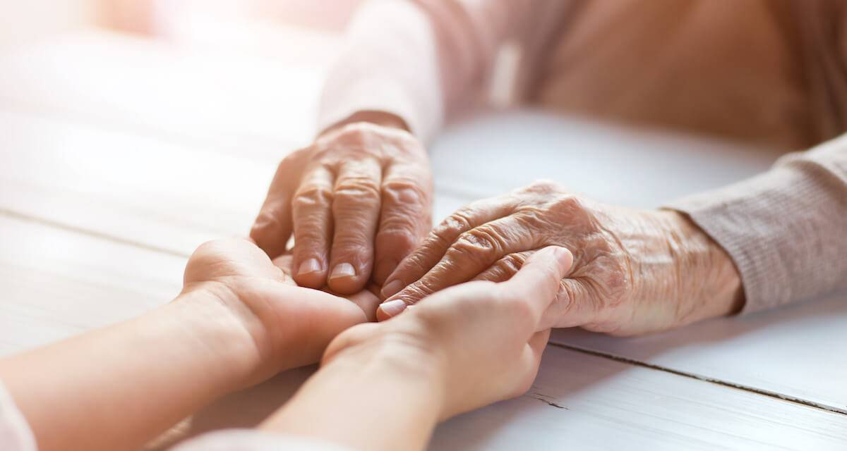 Photo of people holding hands across a table. Rewire PBS Love Caregivers