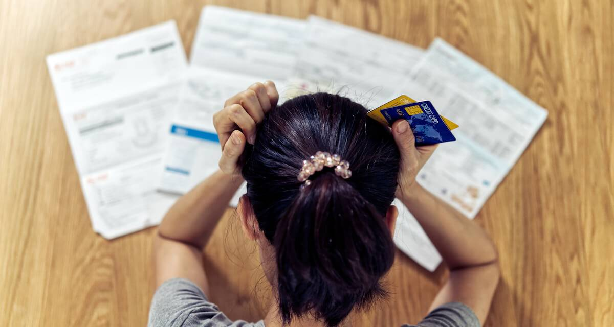 A woman with several credit card bills. Rewire PBS Work Credit Card