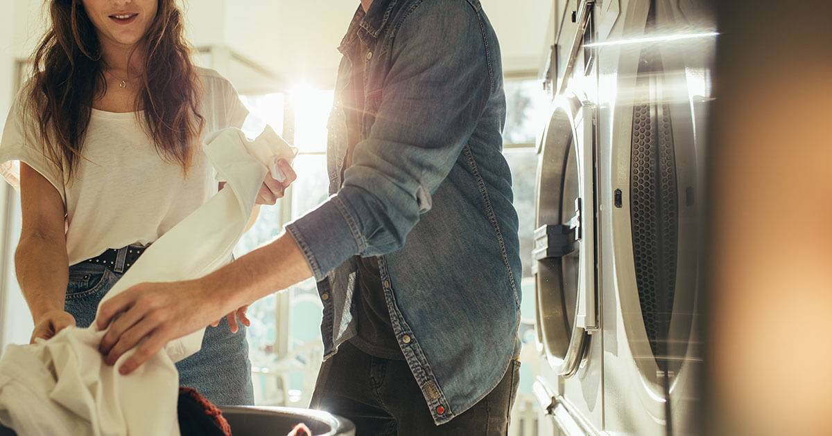 A man and woman couple does laundry together. REWIRE PBS Love housework