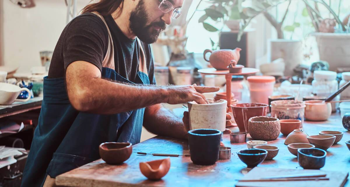 An artist makes pottery in a studio. Rewire PBS Work Dream