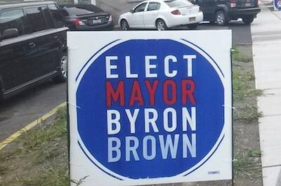 "A campaign sign that says ""Elect Mayor Byron Brown"" Rewire PBS Our Future Political Donation"
