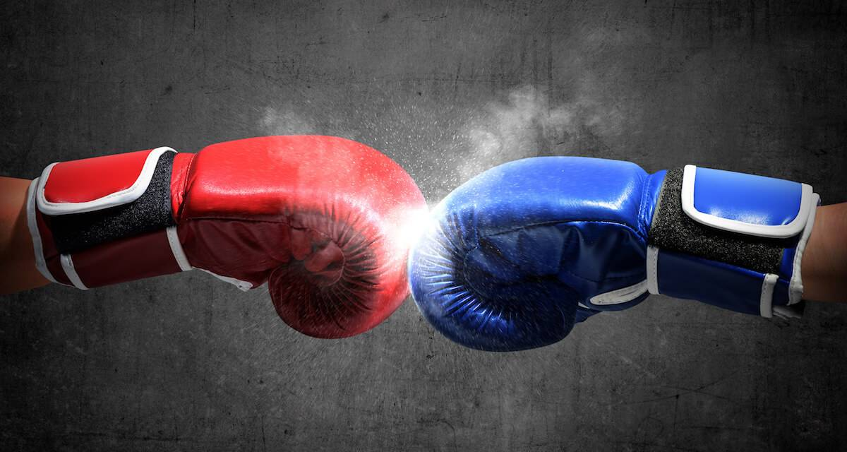 A photo of a red and blue boxing glove punching toward each other. Rewire PBS Our Future Social Media