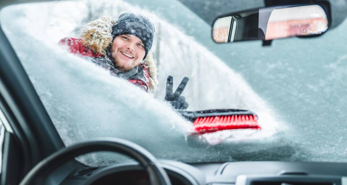 Person looking through snow covered car windshield. Living Winter Car Care Rewire PBS