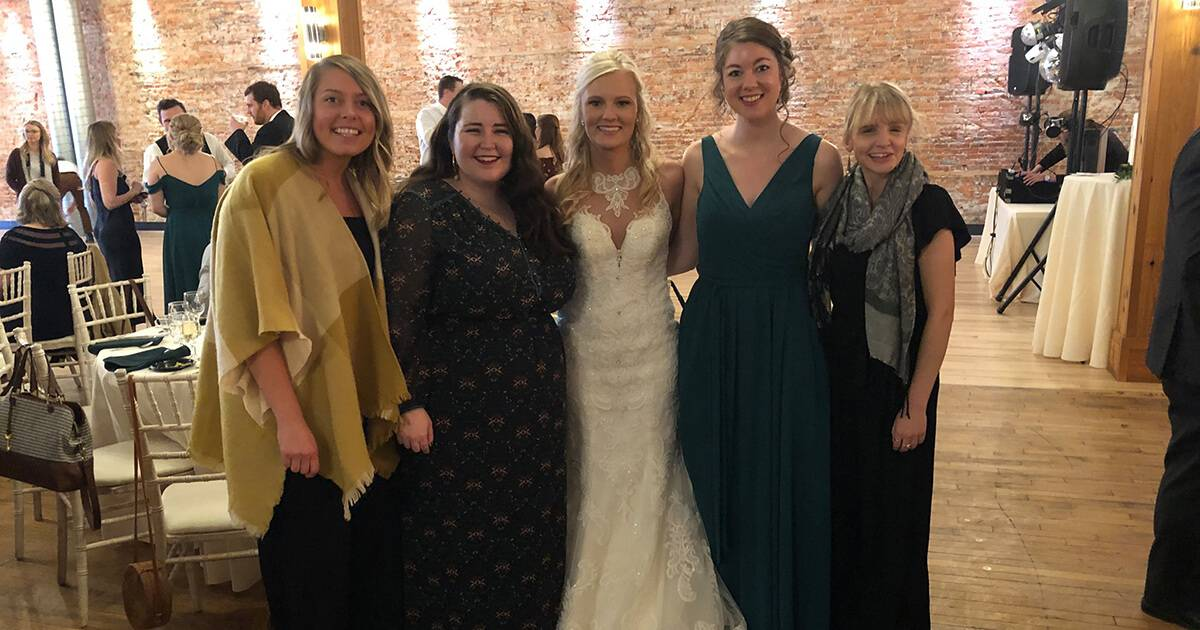 A group of friends poses with the bride at a wedding. Rewire PBS Love Weddings