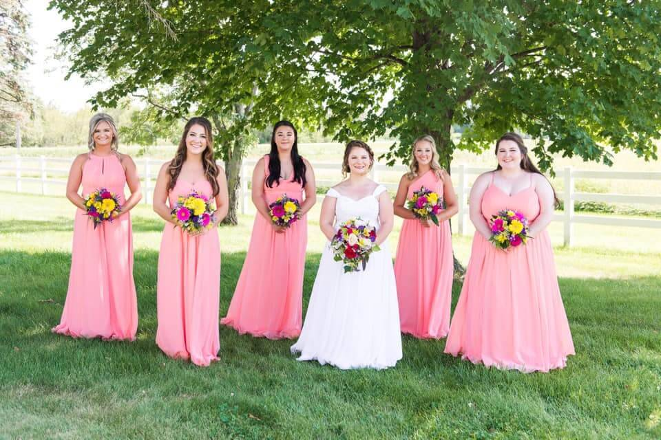 Bridesmaids and a bride pose before a wedding. REWIRE PBS Love Weddings