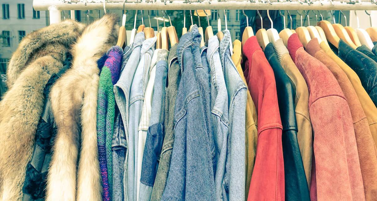 Secondhand clothes hanging on a rack. Rewire PBS Living Thrift stores