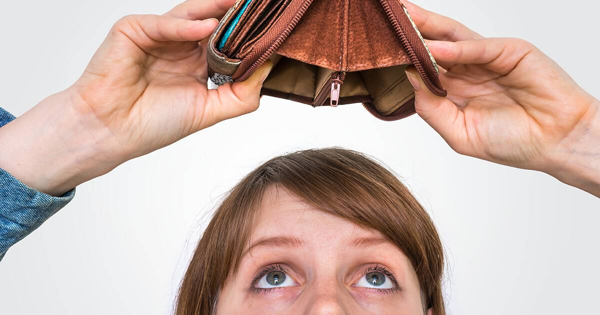 Photo of someone looking up into an empty, overturned wallet. Rewire PBS Work Money
