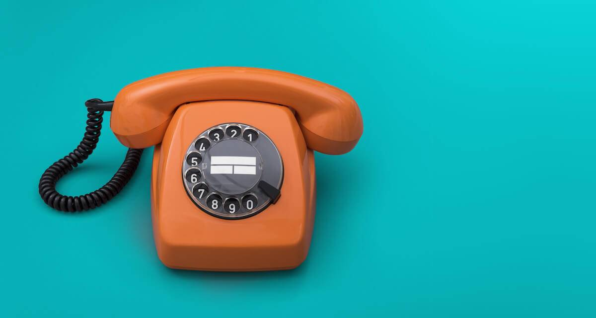 a photo of an old-timey orange rotary phone on a turquoise background. Rewire PBS Our Future Volunteering