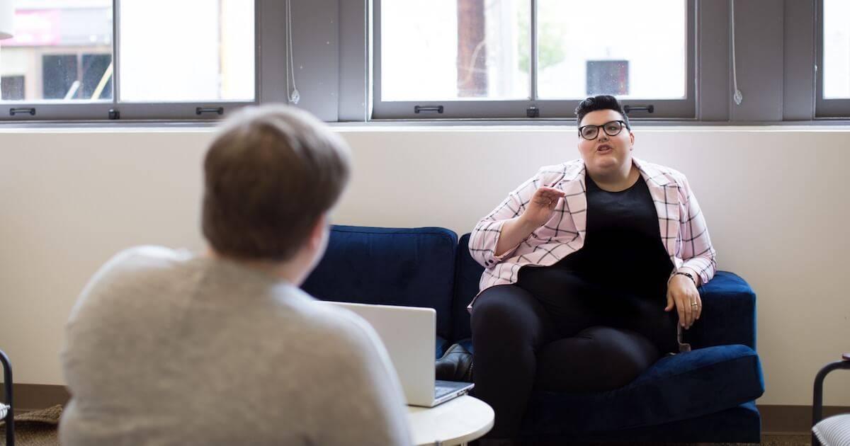 Photo of two people talking. Rewire PBS Work Peer Mentor