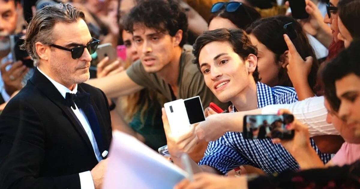 Photo of a bystander taking a picture of Joaquin Phoenix on the red carpet. Rewire PBS Our Future Red Carpet.