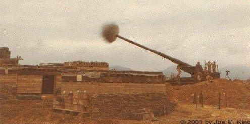 A cannon firing off a shot.