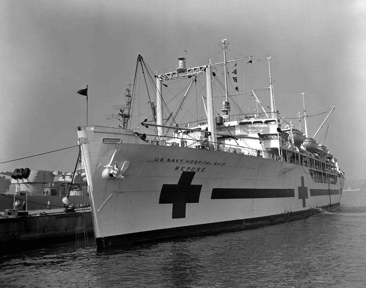 Large white ship with a red cross on its side.