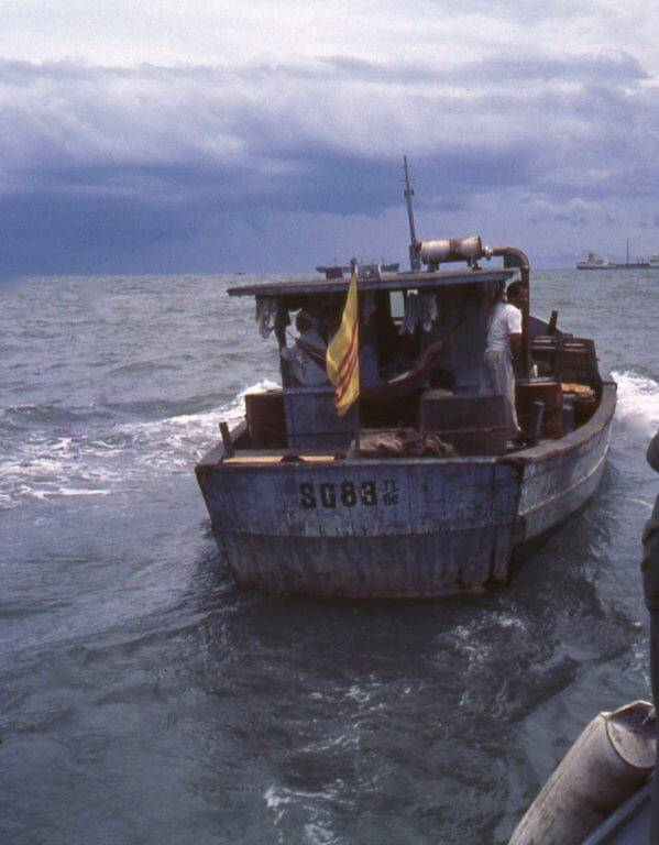 Small Vietnamese water vessel on the ocean.