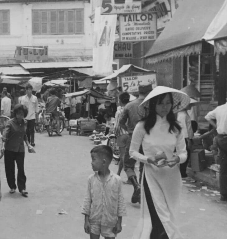 Black and white photo of a Vietnamese street marketplace.