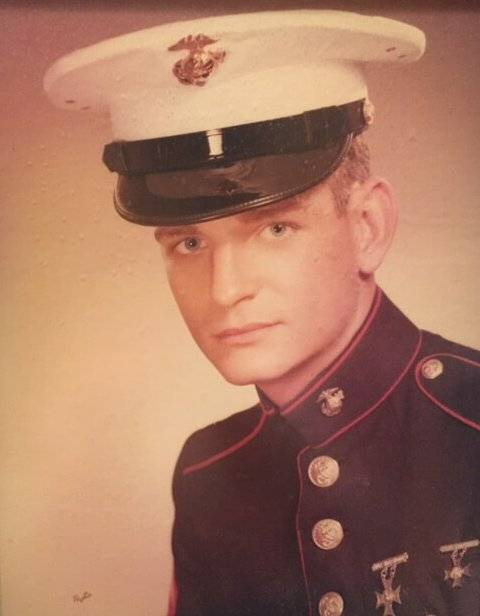 An official Marine portrait of a young man.