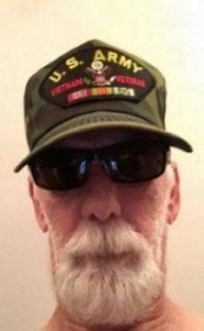 Contemporary photo of an aged Vietnam veteran, sunglasses and U.S. Army Vietnam vet ball cap on.