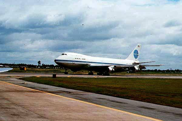 A Pan Am airplane on an air strip.