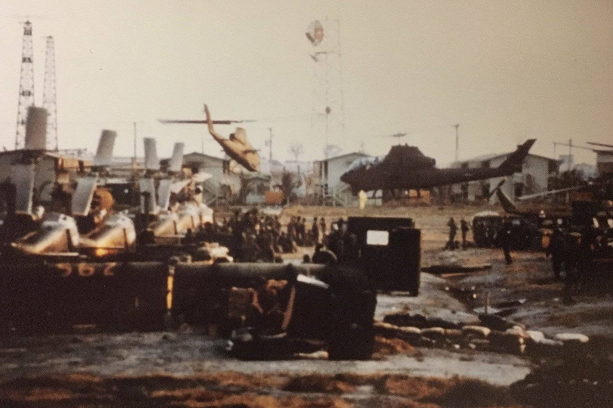 Helicopters and other vehicles on a base.