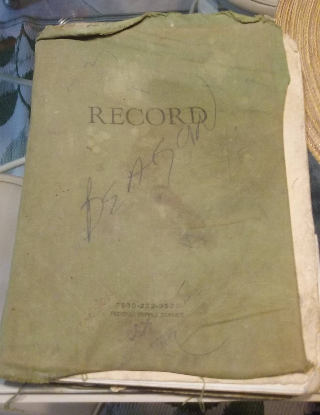 "Exterior of a journal. In print: ""RECORD""; in scrawl: ""BEAGAN""."