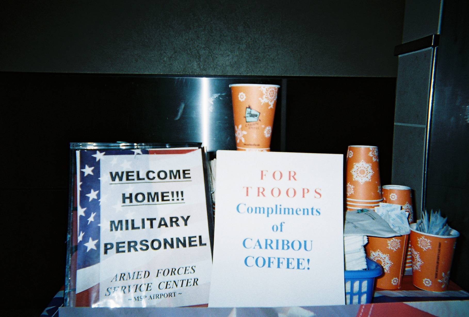 Welcome Home! Signage and Caribou Coffee complimentary drinks.