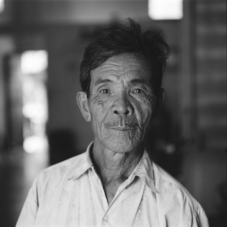Portrait of an aged Vietnamese soldier.