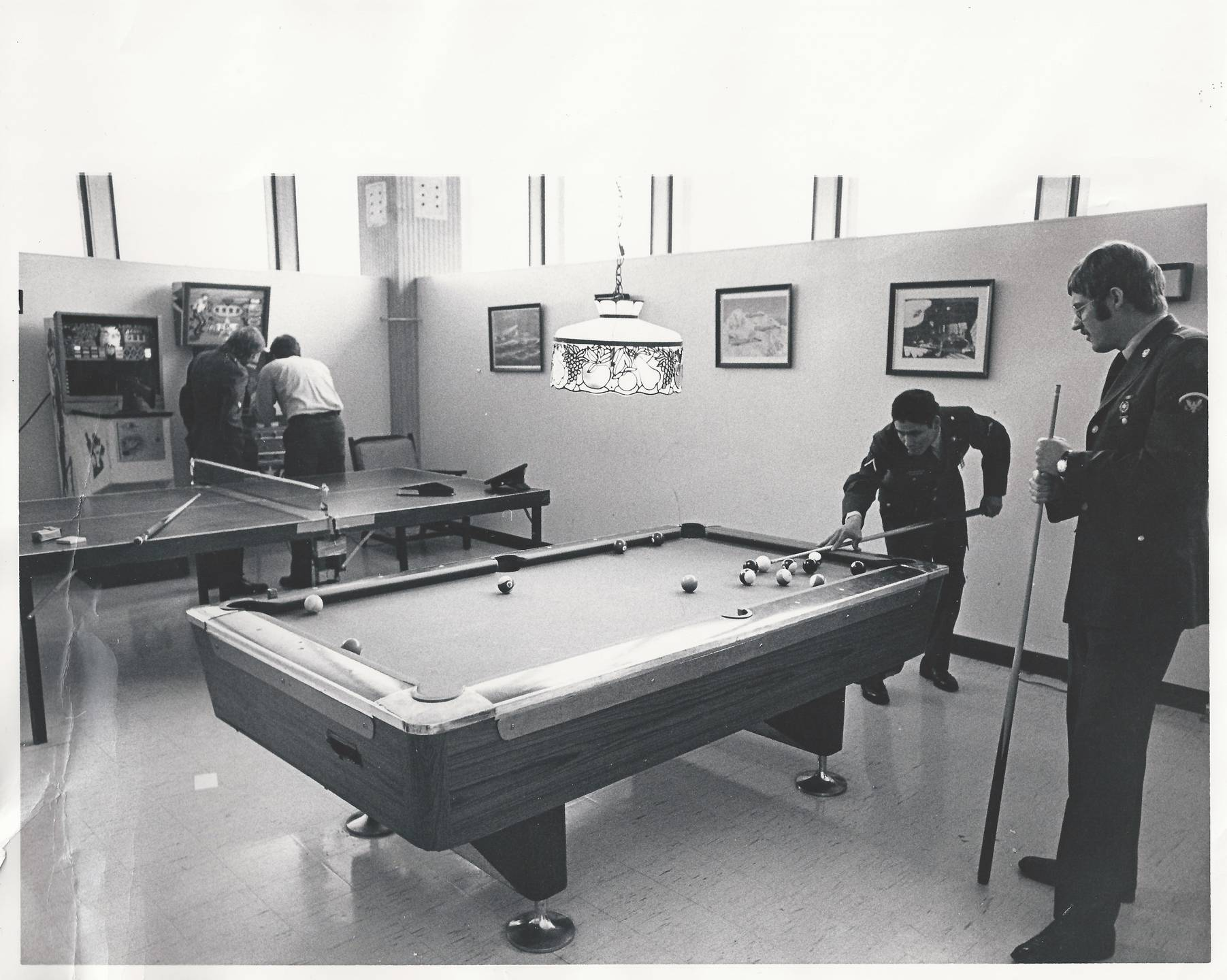Two men playing pool.