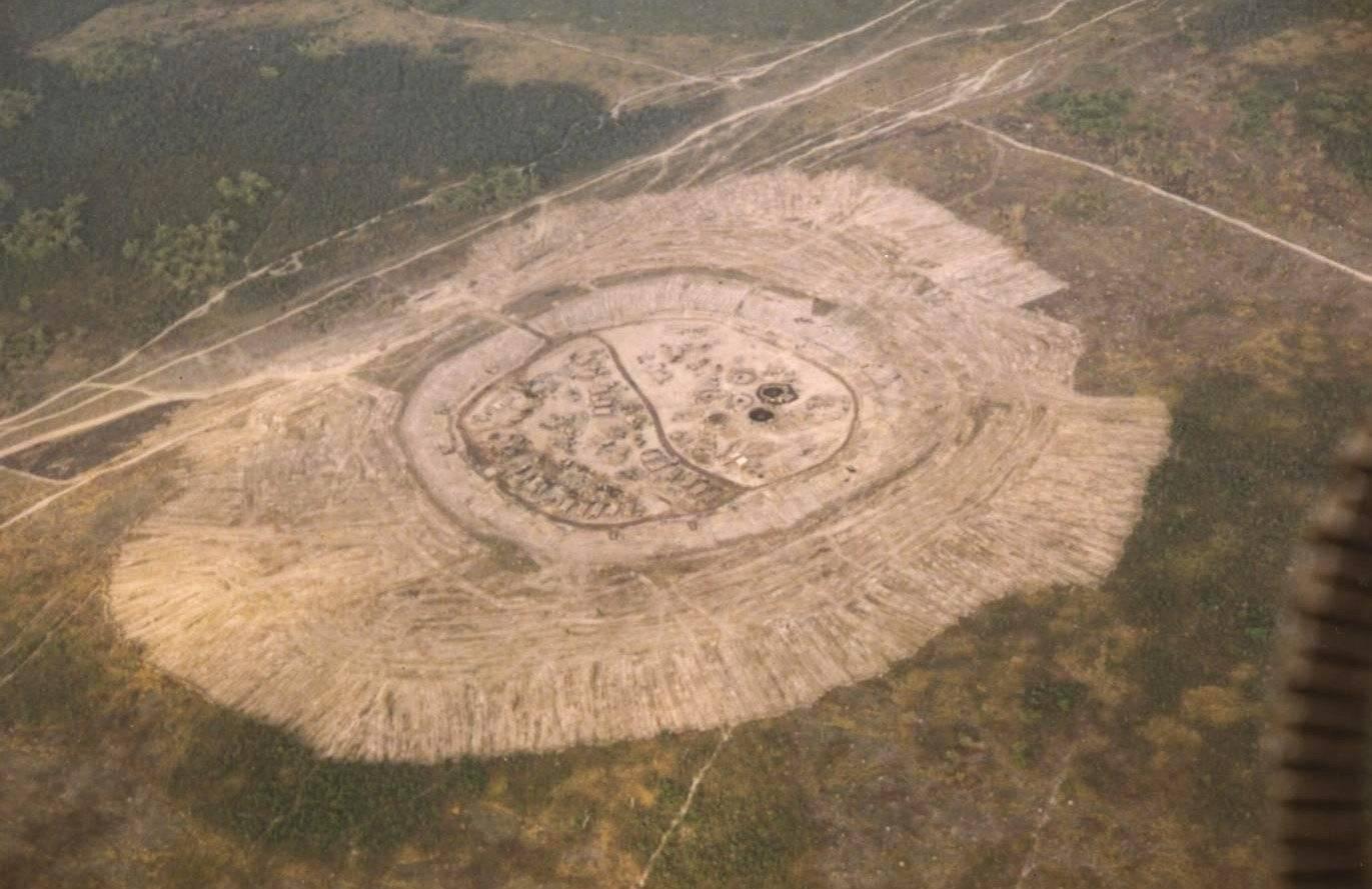 Aerial shot of barren-looking encampment.