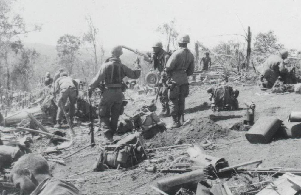 Soldiers and gear strewn about a hill side.