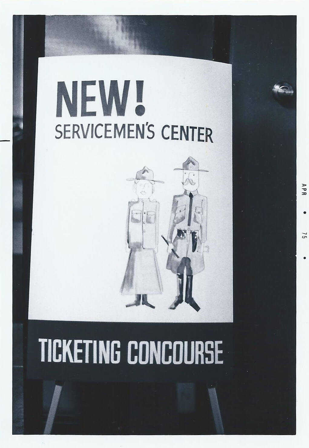"Poster for a ""New! Servicemen's Center"" with illustrated servicewoman and serviceman."