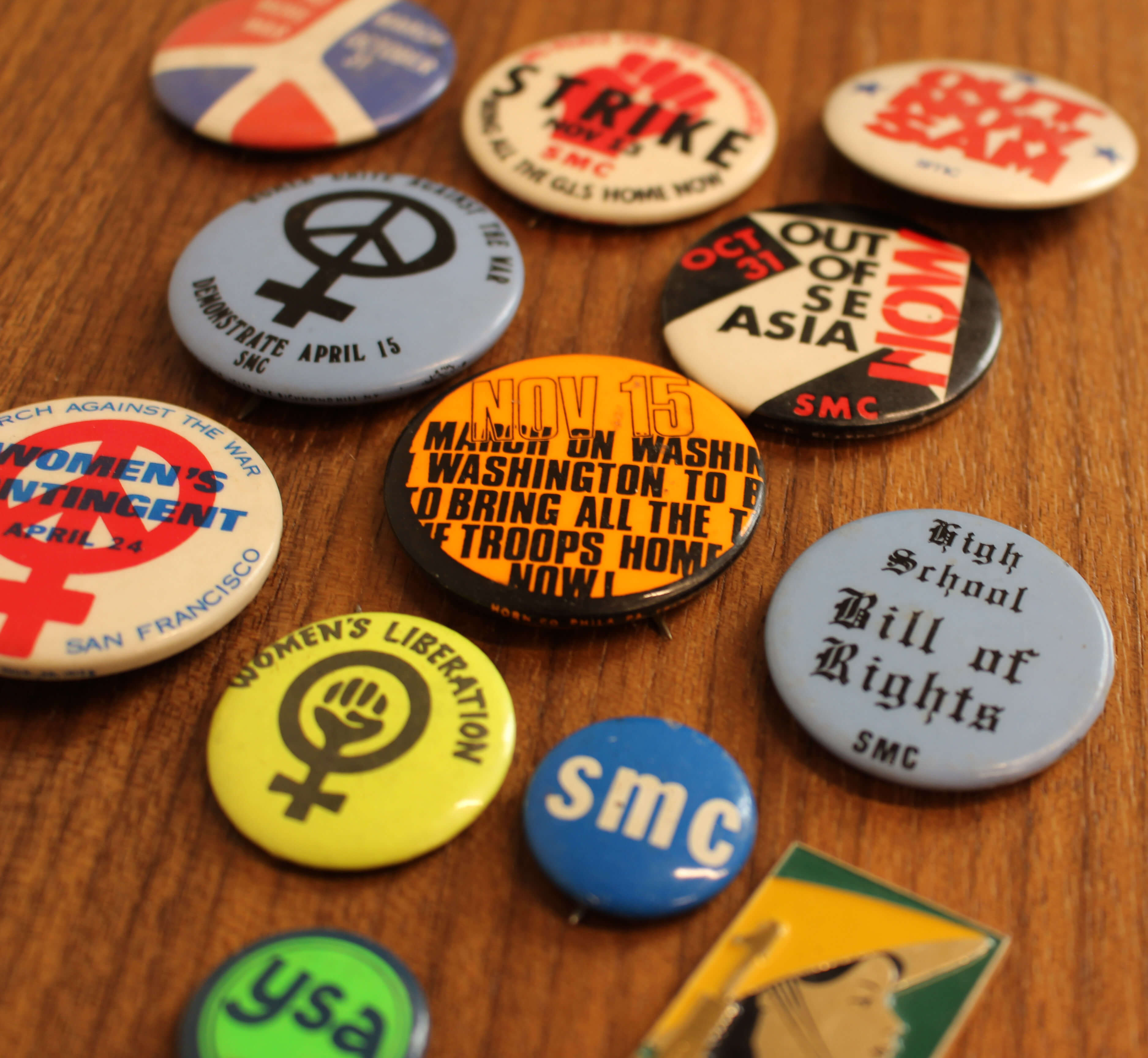 A collection of antiwar movement buttons.