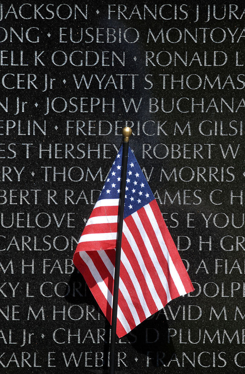 Vietnam memorial wall with American Flag.