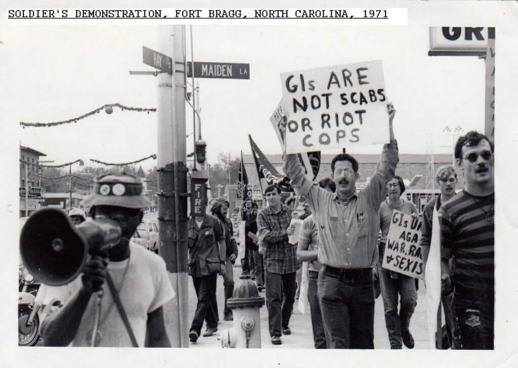 Group of young people protesting the Vietnam War with signs.