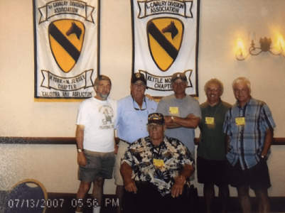 Contemporary photo of 6 older gentleman at a reunion for the 1st Cavalry. Photo timestamp is 07/13/2007 05:56 PM