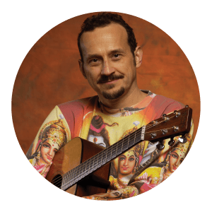 Circular portrait of a man with a guitar.