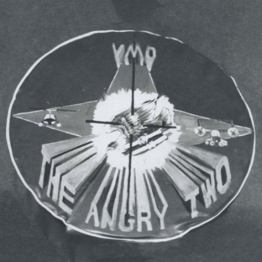 """An insignia that says """"VMO The Angry Two"""" with cross hairs trained on the center."""