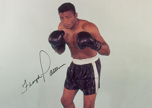 A signed photograph of Floyd Patterson, shirtless with his boxing gloves on.