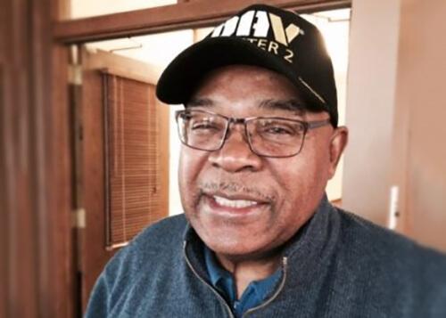 Contemporary photo of an older black man, wearing a Disabled American Veterans DAV ball cap.