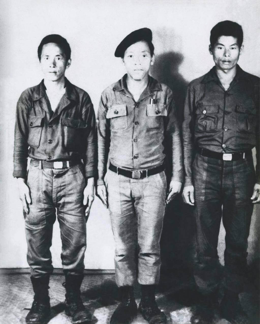 Black and white photo of three Hmong soldiers.