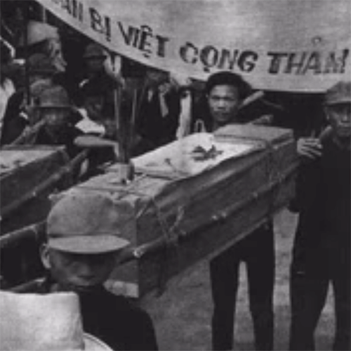 Vietnamese men carrying a casket.