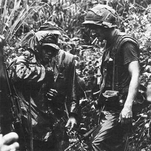 A small group of U.S. soldiers in the jungle.