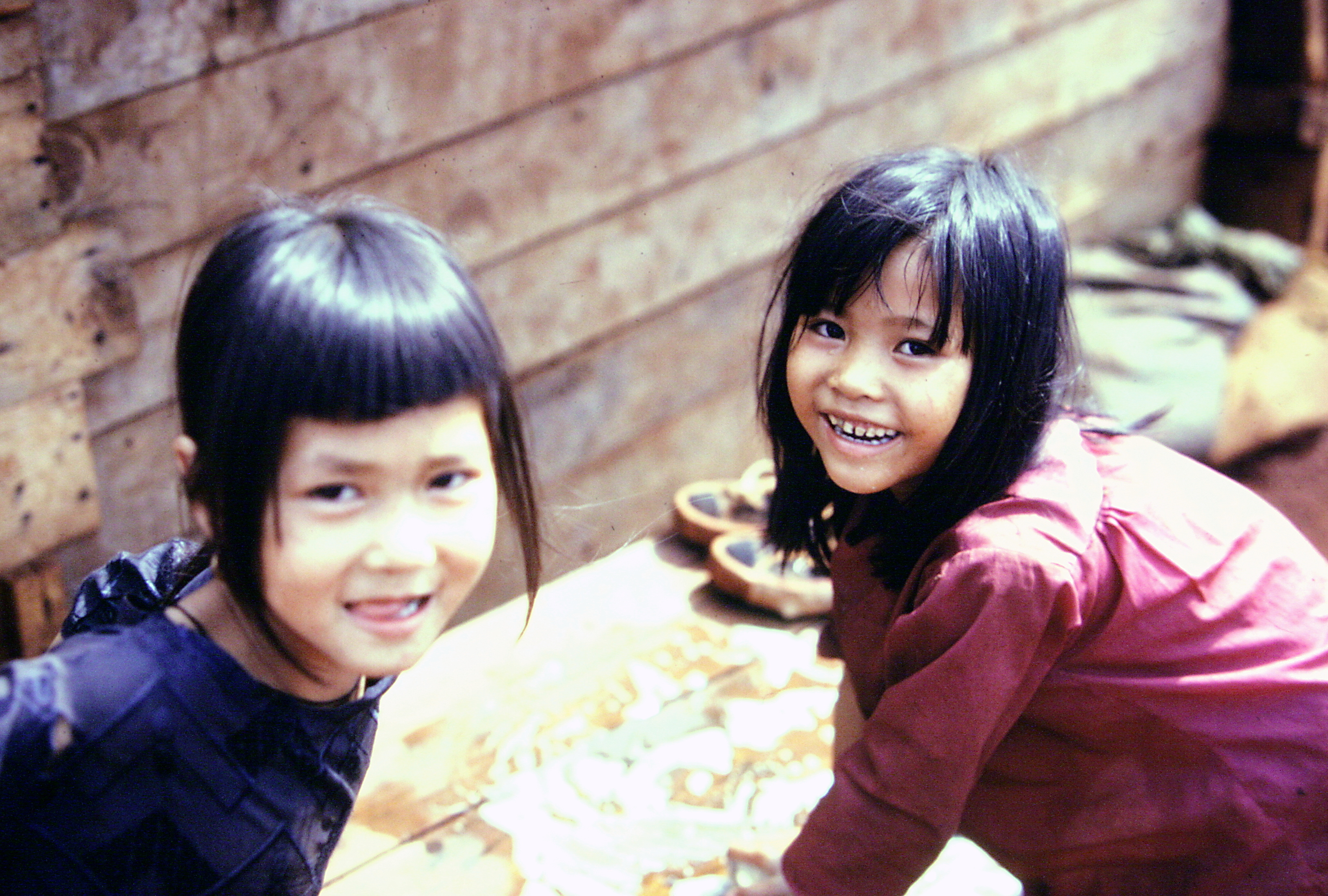 Two young Montagnard girls smiling.